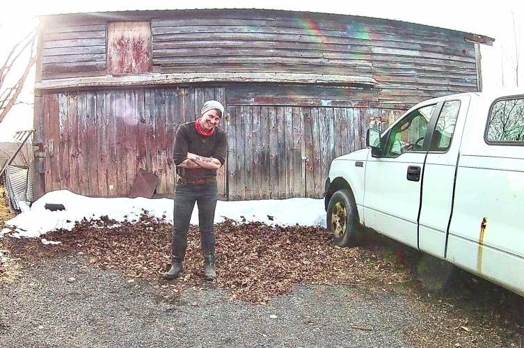 Farmer Lee Hennessy in front of barn