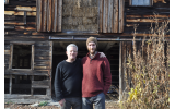 Larry Steel and Anthony Mecca stand in front of a barn at Great Song Farm